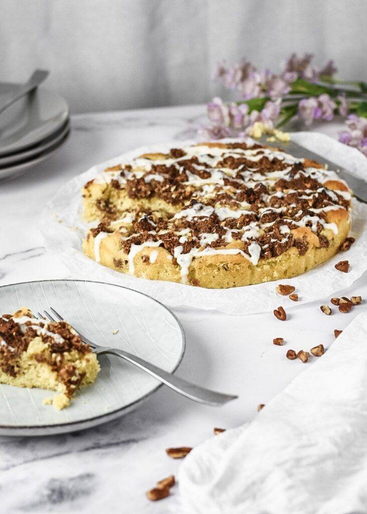 sweetketolife.com-keto-cinnamon-roll-coffee-cake-peacan-drizzle-cheese