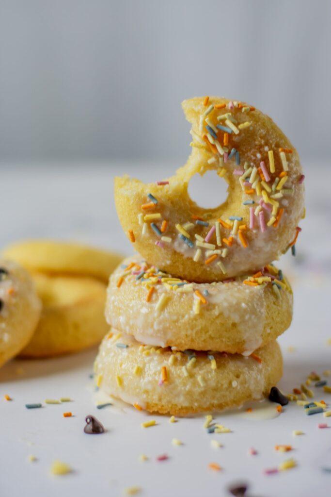 sweetketolife.com-almond-flour-doughnuts-glazed-vanilla-sprinkles-cream-cheese-sugar