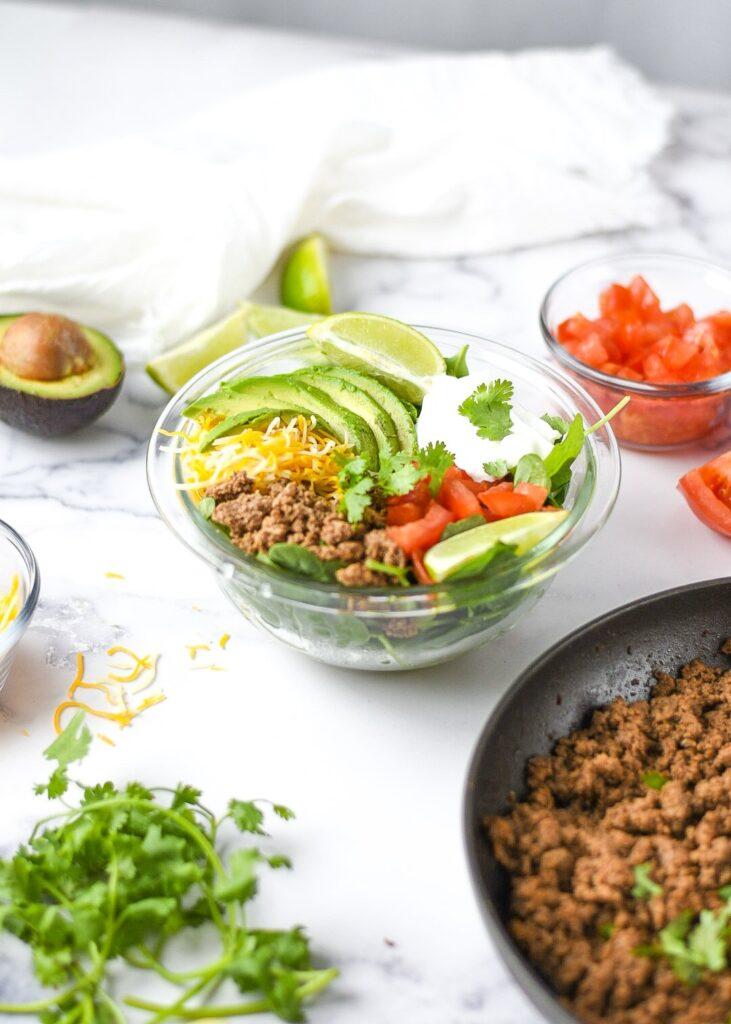 moresweetthansalty.com-taco-salad-for-keto-ingredients-cheesy-ground-beef-seasoning-fresh